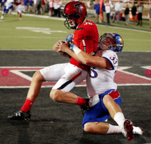 Jayhawks Keith Lineker tackles the Tech punter for a first half safety -photo University of Kansas Athletics
