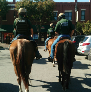 Police seek driver who nearly hit mounted Kansas officers