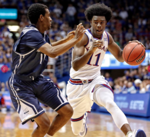 Josh Jackson drives to the basket in his first game for the Jayhawks-photo  by University of Kansas Athletics