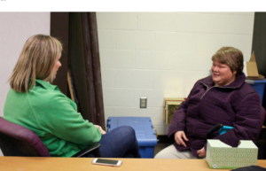 Kim Turley, left, of the Topeka Rescue Mission talks with Ashlyn Harcrow, who is staying at the mission as she recovers from domestic violence and tries to improve her mental health amid post-traumatic stress disorder, depression and anxiety. ANDY MARSO / HEARTLAND HEALTH MONITOR