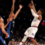 The Latest: Kansas' Mason named AP player of the year