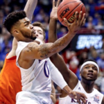 Kansas holds off upset bid Oklahoma State