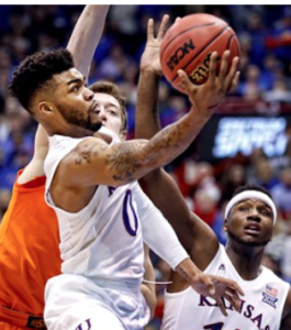 Kansas holds off upset bid Oklahoma State