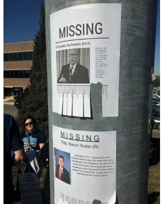 Posters Label Sen. Pat Roberts And Rep. Kevin Yoder As U201cmissing.u201d CREDIT  JIM MCLEAN / KANSAS NEWS SERVICE. U201c