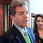The Latest: Brownback critical of Medicaid expansion in Kansas