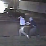 Video: Kansas police officer, suspect struggle over gun