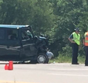 2 hospitalized after van pushes Kan. woman, SUV into ditch