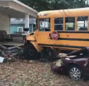Kansas school bus driver placed on leave after crash into house