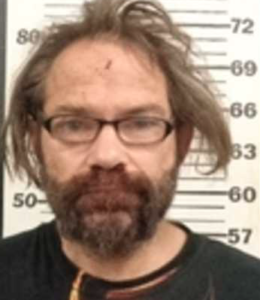 Kan. man charged with murder for setting woman on fire