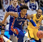 Jayhawks down Mountaineers, move into first place tie in Big 12
