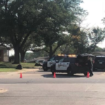 Kan. school placed on secure status during shooting investigation