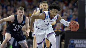 Graham leads No. 1 seed Kansas to win over No. 16 seed Penn