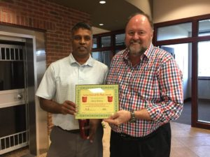 Tom Wilbur, President of BANK VI, presents Selvan Raman with his Hero of the Week Award