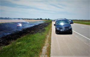 Wheel detaches from van, starts fire