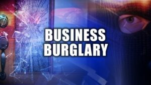 Police searching for a suspect in a hotel burglary
